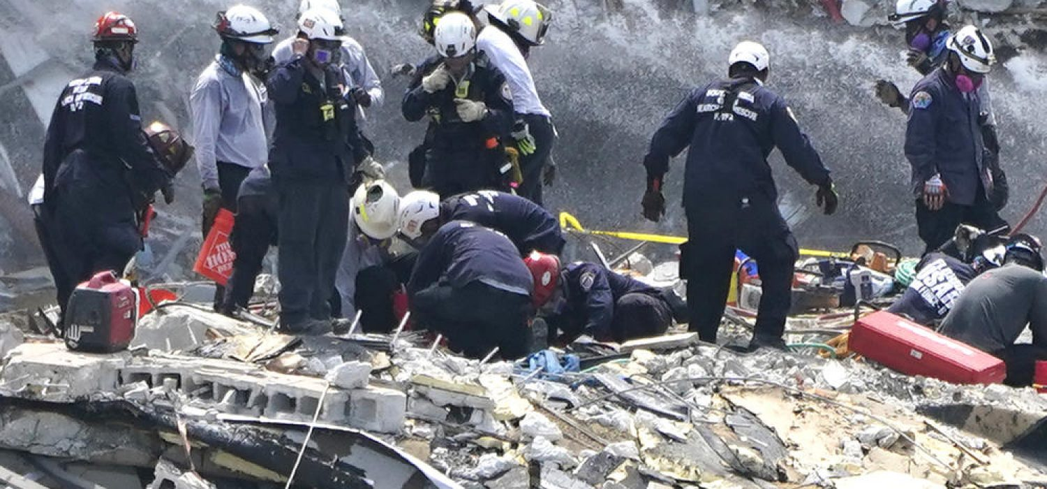 Rescue workers search the rubble of the Champlain Towers South condominium, Saturday, June 26, 2021, in the Surfside area of Miami. The building partially collapsed on Thursday. (AP Photo/Lynne Sladky)